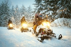 people on snowmobiles